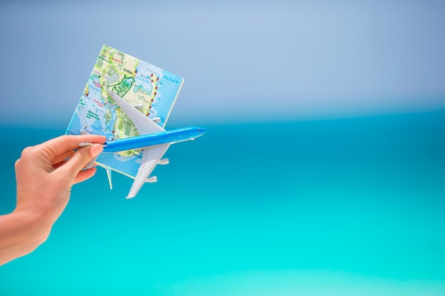 Map and toy airplane the turquoise sea Premium Photo