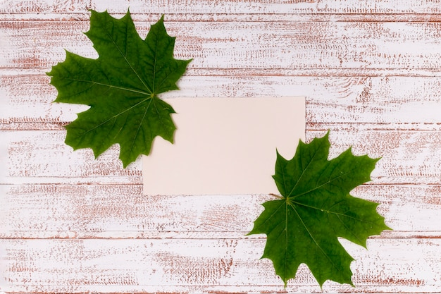 Maple leaves mock-up on wooden desk Free Photo
