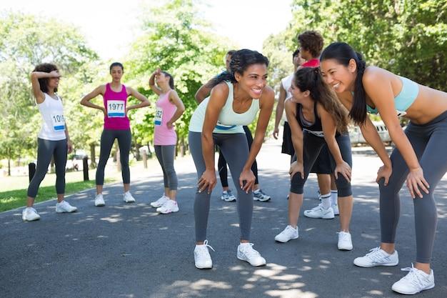 Marathon runners taking a break Premium Photo