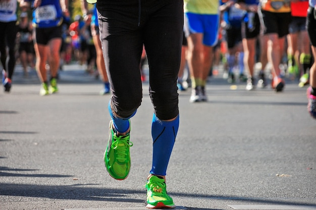 Marathon running race, many runners feet on road racing, sport competition, fitness and healthy lifestyle concept Premium Photo