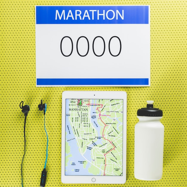 Marathon stuff and tablet with map Free Photo