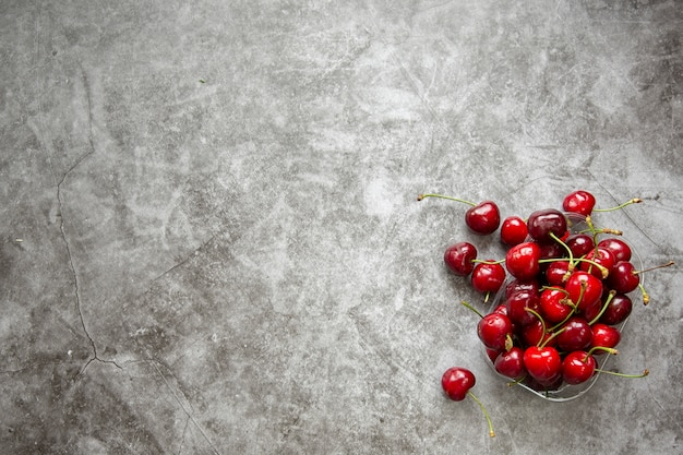 Marble countertop and cherry berries. summer season,harvesting berries ,jam,compotes. Premium Photo
