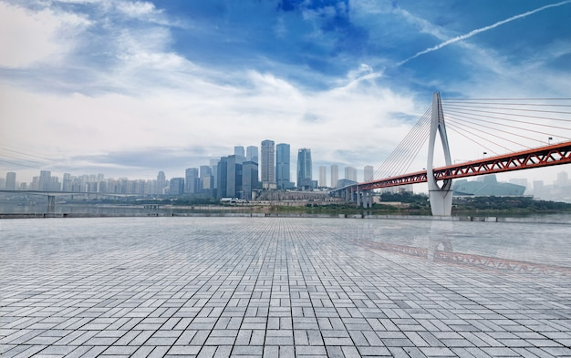 Marble platform in front of the city skyline Free Photo