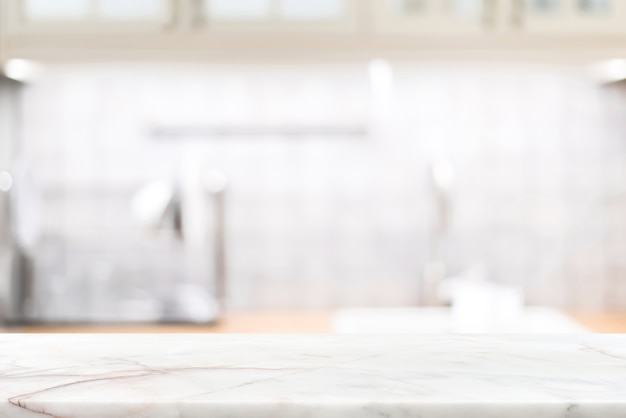 Marble stone countertop on blur kitchen interior background Premium Photo