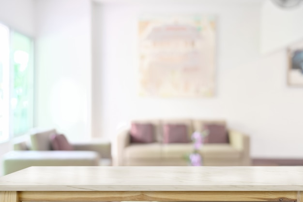 Marble table top over blurred living room background Premium Photo