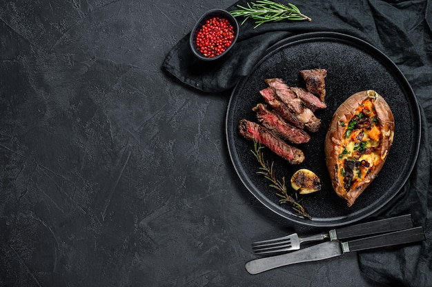 Marbled beef steak with baked sweet potato garnish. grilled meat Premium Photo