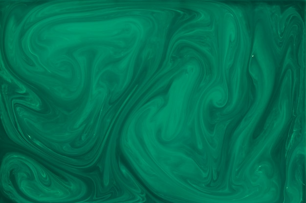 Marbled green fluid abstract background Free Photo