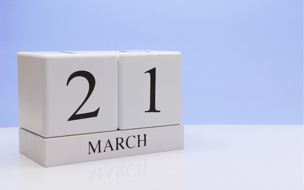 March 21st. day 21 of month, daily calendar on white table. Premium Photo