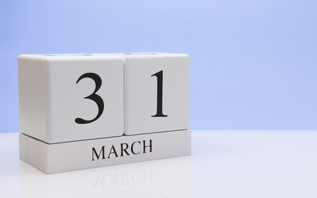 March 31st. day 31 of month, daily calendar on white table. Premium Photo