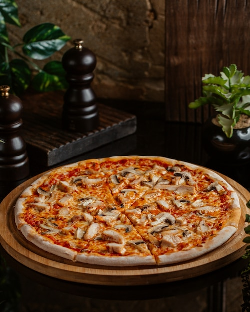 Margarita pizza with mushrooms and tomato sauce Free Photo