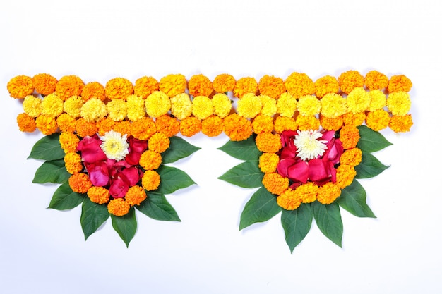 Marigold flower rangoli design for diwali festival , indian festival flower decoration Premium Photo