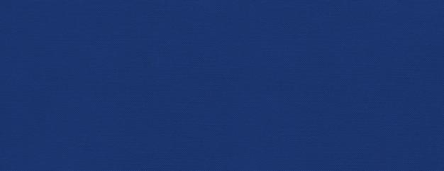 マリンブルーのキャンバスのテクスチャ背景 Premium写真