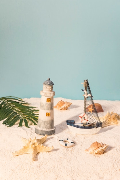Marine toys on sandy beach Free Photo