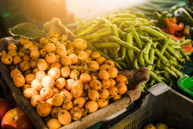 Market stall with variety of organic vegetable Free Photo