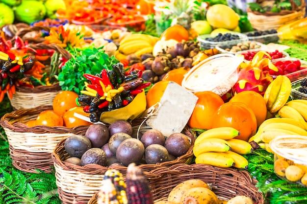 Market with vatiety of tropical fruits in campo di fiori, rome Premium Photo