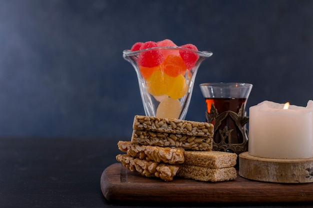 Marmelades and sesame cookies with a glass of tea Free Photo