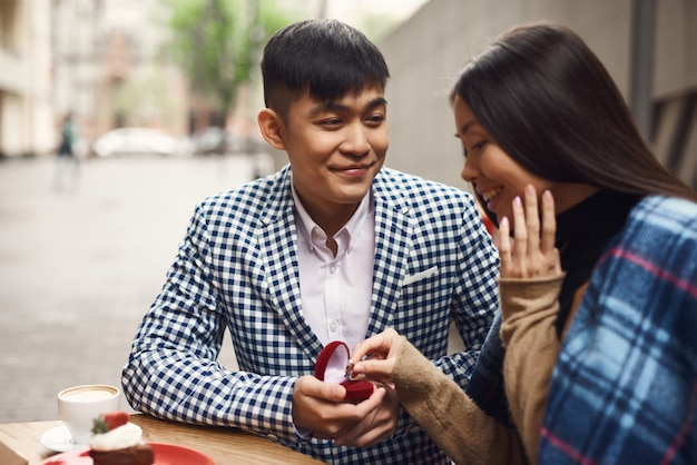 Marriage proposal love story of asian couple. Premium Photo