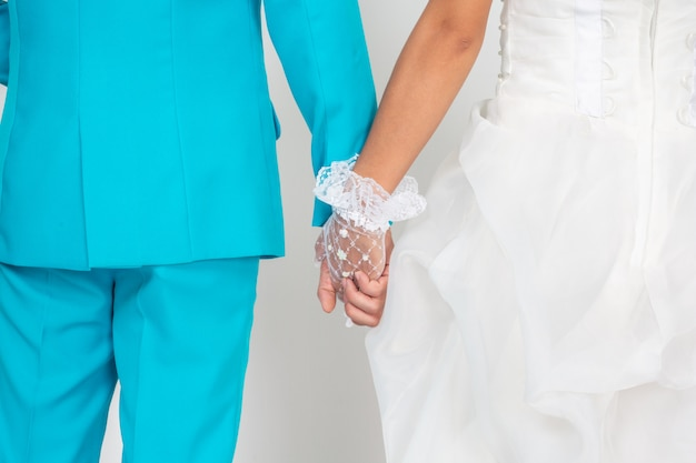 Married couple holding hands. Free Photo