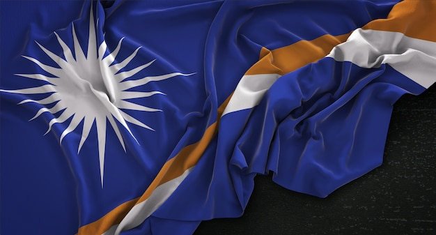 Marshall islands flag wrinkled on dark background 3d render Free Photo