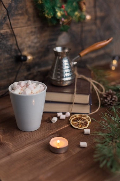 Marshmallows in a cup of cofee with turka in christmas decorations Premium Photo