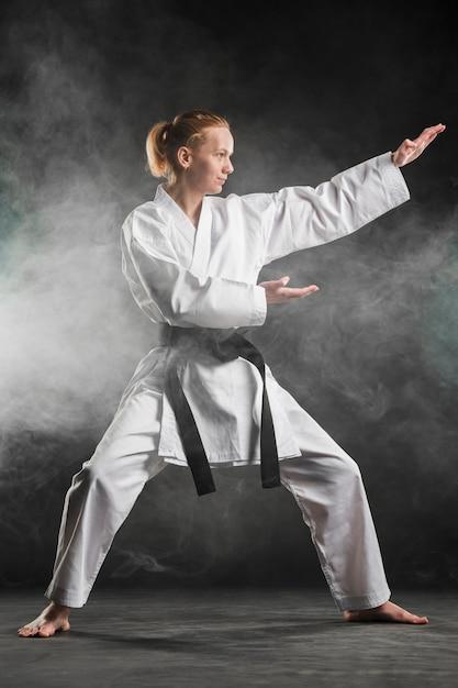 Martial arts fighter posing full shot Free Photo