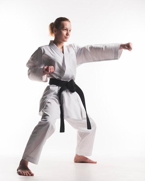 Martial arts karate girl practicing Premium Photo
