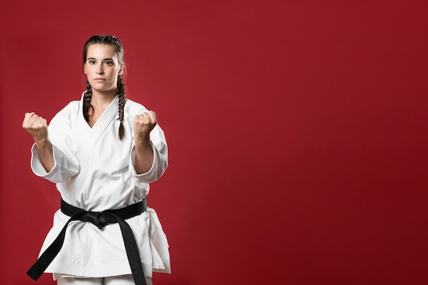 Martial arts karate girl with black belt and copy space background Free Photo