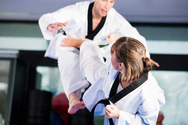 Martial arts sport training in gym Premium Photo