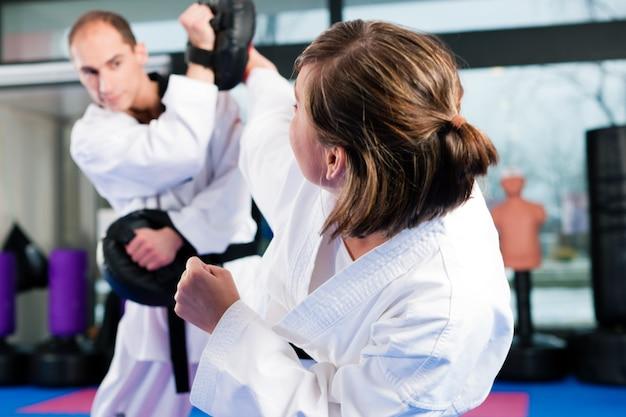 Martial arts sport training in gym Premium Photo