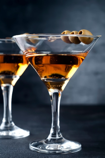 Martini glass and olives Premium Photo