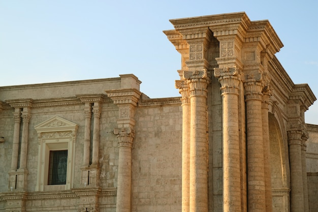 Marvelous facade and the side arch of the basilica cathedral of arequipa, peru Premium Photo