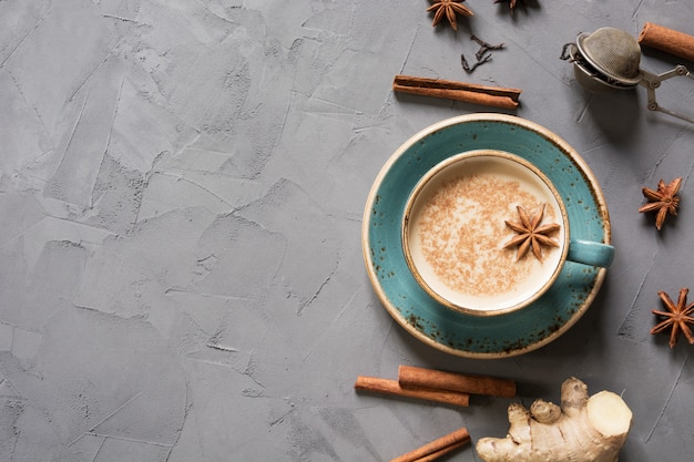 Masala indian tea in cup with spices on grey concrete table. top view. Premium Photo