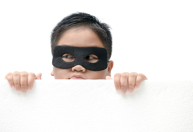 Masked child appeared from below isolated Premium Photo