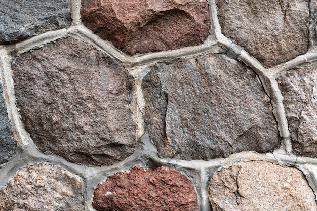 Masonry stone abstract texture on ancient foundation of cathedral. Premium Photo