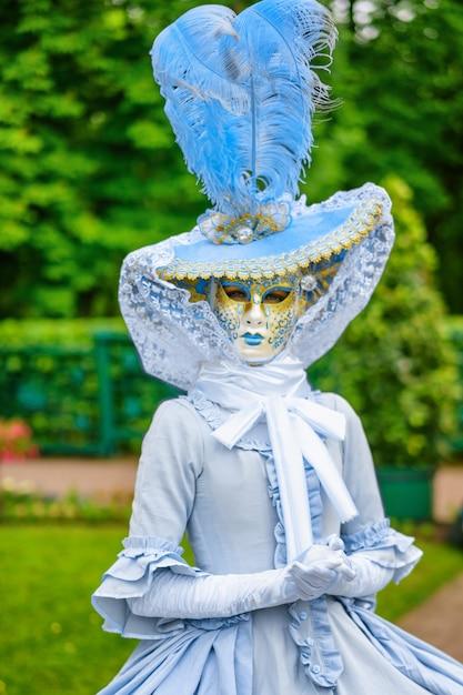 Masquerade ball, a woman in a beautiful dress and venetian mask Premium Photo