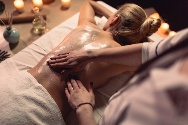 Massage concept with woman lying down Free Photo