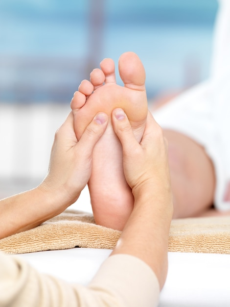Massage on the foot in spa salon, close-up Free Photo