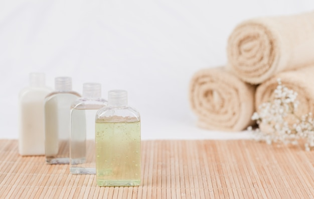 Massage oil and towels Premium Photo