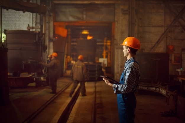 Master looks on steelmaking process in furnace Premium Photo