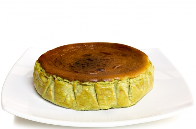 Premium Photo Matcha Green Tea Basque Burnt Cheesecake Isolated On White Background
