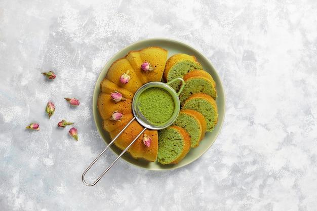 Matcha green tea bundt cake on grey stone  top view copy space Free Photo