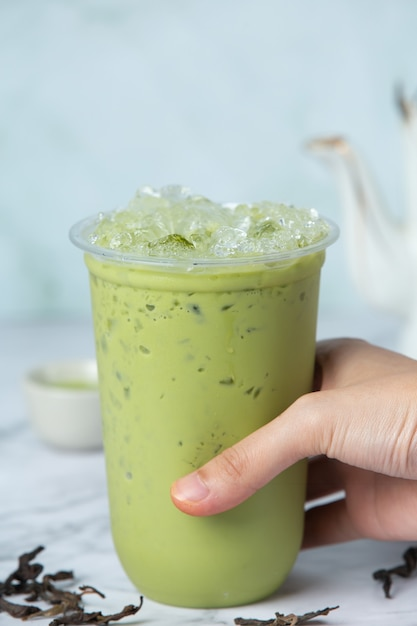 Matcha ice green tea on marble floor it is a delicious and nutritious Free Photo