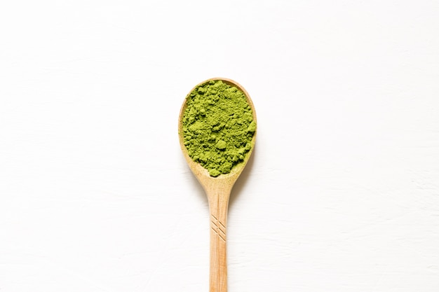 Matcha. japanese powdered green tea in a spoon on a white background. top view and copy space. Premium Photo