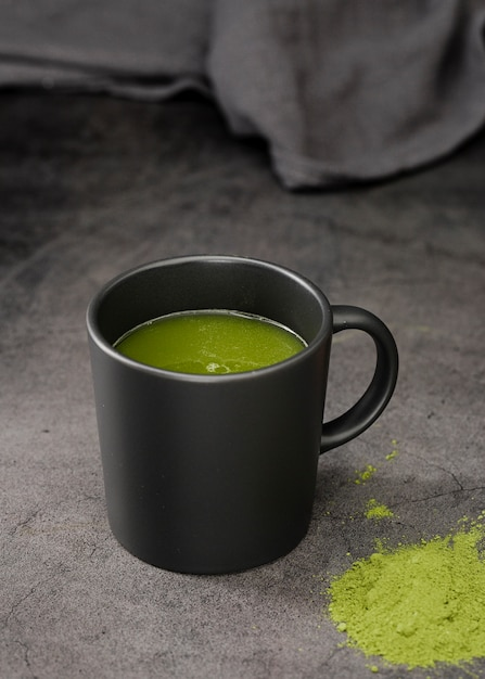 Matcha tea in cup with powder Free Photo