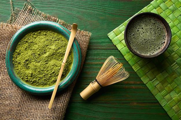 Matcha tea powder bamboo chasen and spoon Premium Photo
