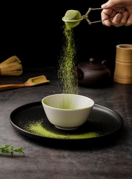 Matcha tea powder sieved in bowl Free Photo