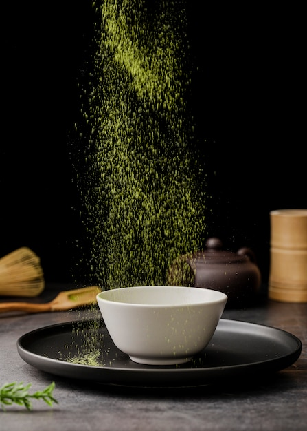 Matcha tea powder sieved in bowl Free Photo