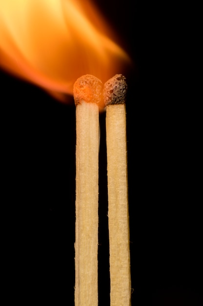 Matches on a black background Premium Photo