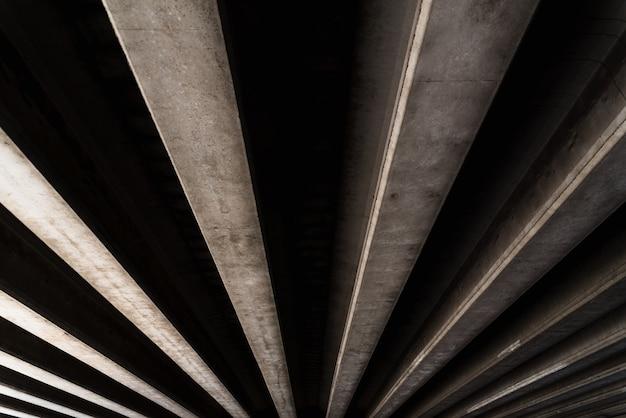 平行に配置されたコンクリートテクスチャを持つマテリアルの背景 Premium写真
