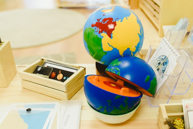 Materials in a classroom for students of montessori alternative pedagogy. Premium Photo